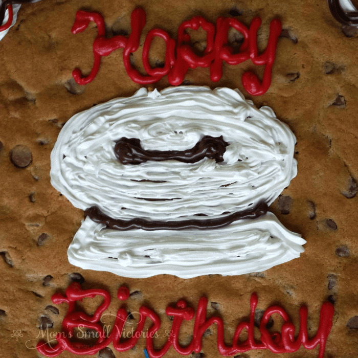 Make this Easy Chocolate Chip Cookie Cake for any holiday, potluck or birthday party for a simple dessert that is sure to wow a crowd!