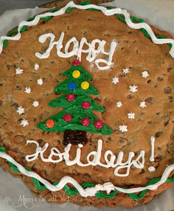 This Easy Chocolate Chip Cookie Cake is a simple holiday dessert that is sure to please a crowd!