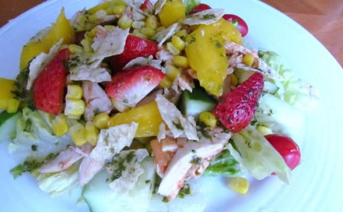 Cilantro-Lime Salad Dressing is a light and refreshing addition to your favorite salad. I used it on top of lettuce, leftover shredded chicken, mango and strawberries for a salad with a tropical flair.