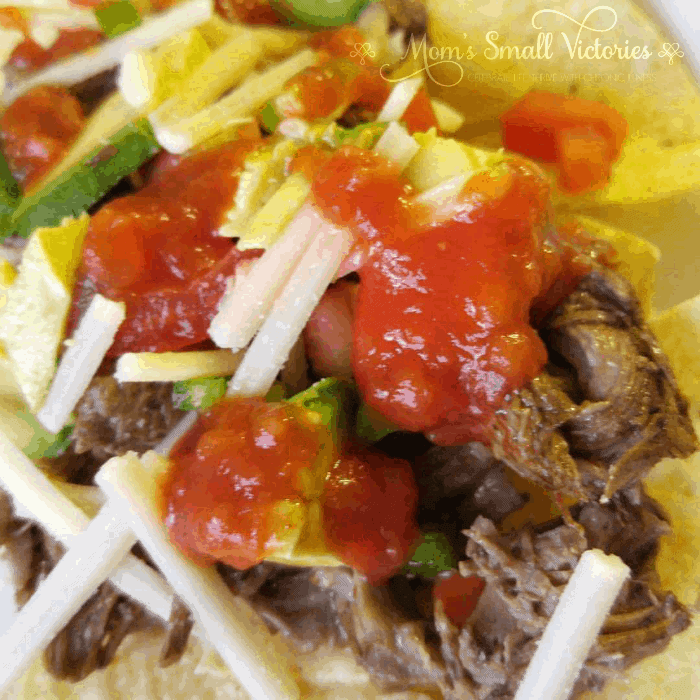 Slow Cooker Chipotle Barbacoa is an amazing delicious dairy, sugar and gluten free recipe that will make your tastebuds sing. Serve it in tacos or on top of nachos with dairy free cheese. Also makes an easy and impressive dish for parties set up as a taco or nacho bar your guests are sure to love.