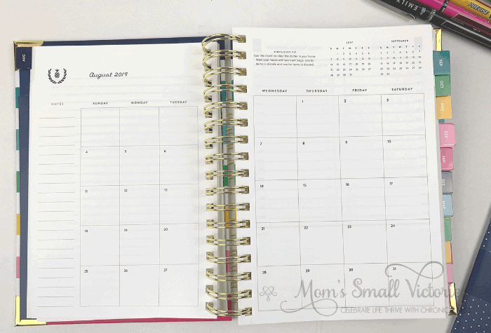 The Daily Simplified Planner Review. The monthly calendar fits on 2 pages and has small pops of color, the previous month and next month's calendars at a glance and a Simplicity tip.
