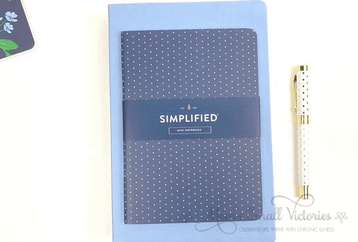 """The Dapperdesk Planner Review 2020. The sky blue dapperdesk planner is 6"""" x 9"""" with a 5"""" x 7"""" navy dot mini notebook on top."""